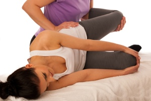 physiotherapy -therapist excercising with patient , working on l